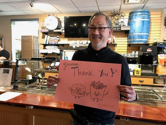Dan Lew, the owner of Dan Lew Exchange at 28 N. Main St., downtown, is celebrating customer appreciation week with free cheeseburgers and fries 11 a.m. to 2 p.m. this week through Friday. Lou Whitmire/News Journal