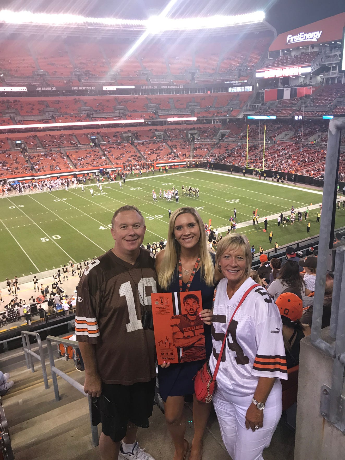 2013 Mansfield Senior grad Victoria Leahy and her parents enjoy a game experience together when she worked for the Cleveland Browns.