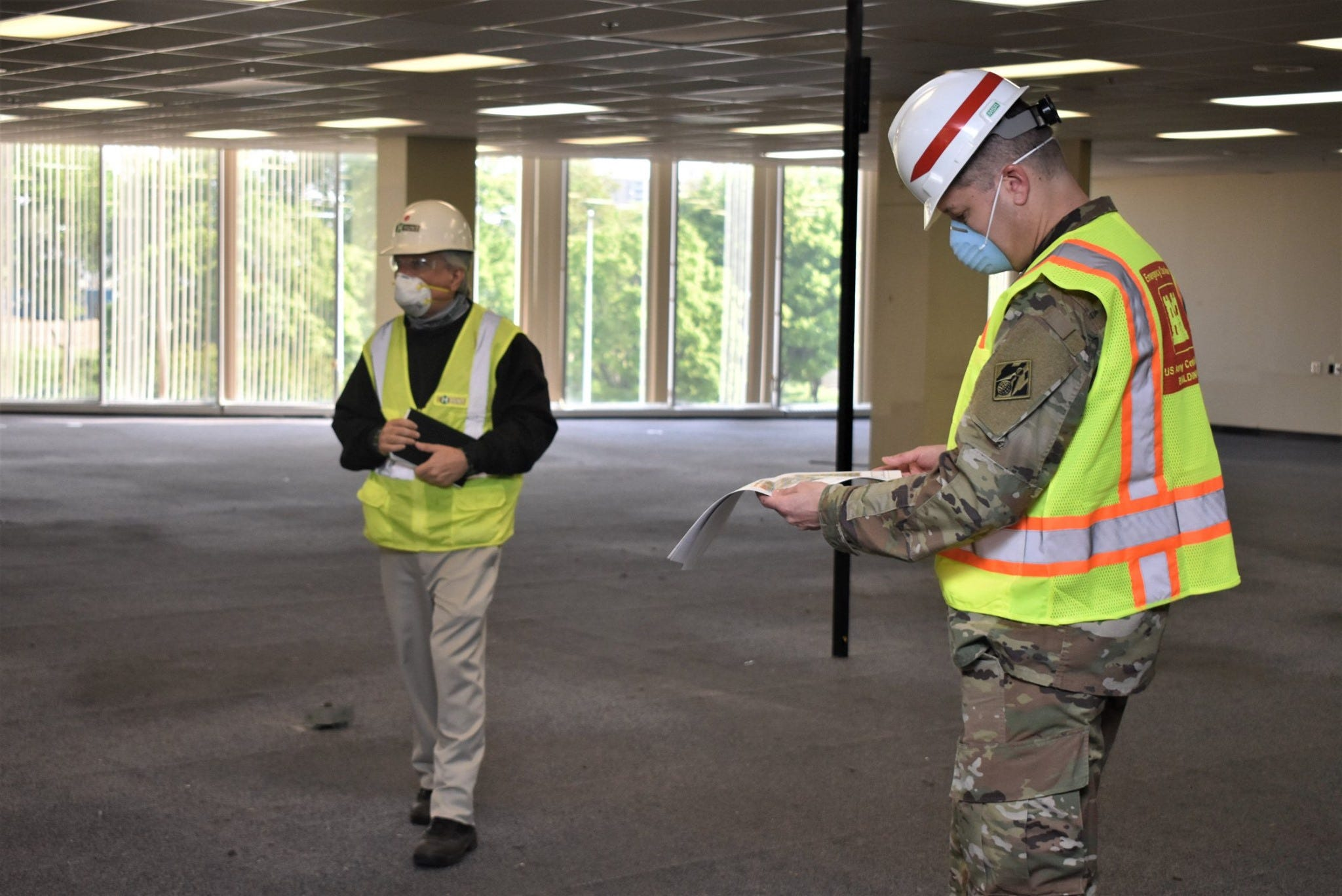 A U.S. Army Corps of Engineers worker reviews plans for the third floor of the former Commercial Appeal building in Memphis, which is being renovated as an Alternate Care Facility to treat COVID-19 patients. The Army issued a $51.4 million contract to AECOM for the project in April.