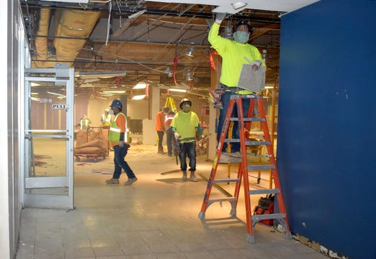 Construction continues Thursday, April 23, 2020, to convert the former Commercial Appeal building on Union Avenue to a COVID-19 temporary hospital.