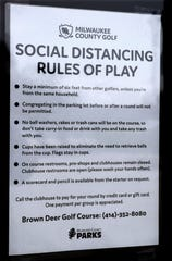 New rules for playing golf at Brown Deer Golf Course are posted on the door Thursday.