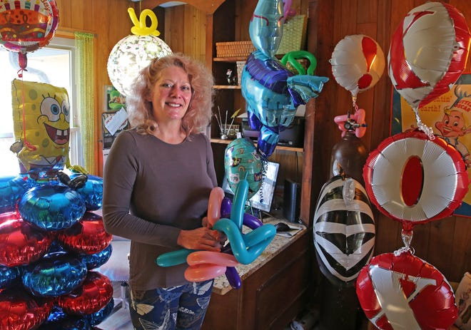 Brigette DuVal-Begos on Tuesday, April 21, 2020 at her Brookfield home surrounded by balloons from her business. DuVal-Begos thought 2020 would be the best year yet for her one-woman company, Brigette's Bargain Balloons. Just in July with the DNC, she expected to make at least triple what she earned that same month last year.
