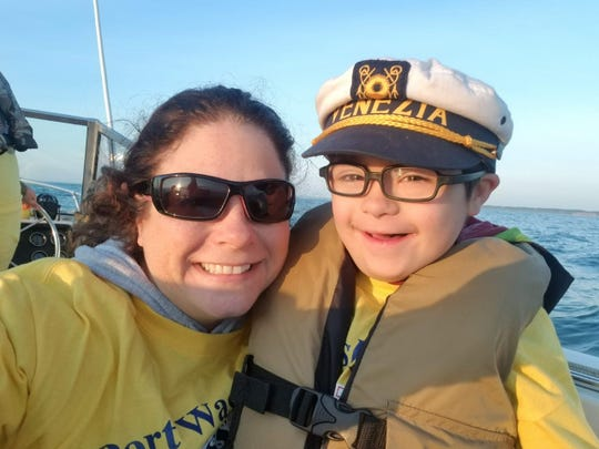 Beth Wisniewski on a boat during  previous summer outing with her son, Henry