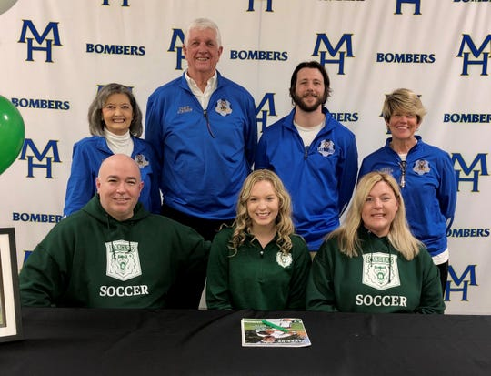 Mountain Home's Sarah Swonger (front, center) signed Thursday to play college soccer at the University of Wisconsin-Parkside. Pictured with Swonger are: (front row, from left) her father Darin Swonger, her mother Melissa Swonger; (back row) Lady Bomber head coach Debbie Atkinson, MHHS assistant coach Max Atkinson, MHHS assistant Ian Biggs, and MHHS assistant Cathy Beckham.