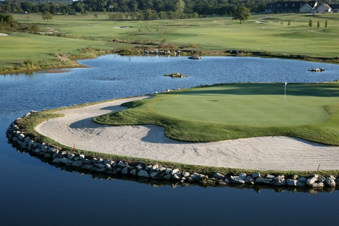 A view of the famous No. 10 green at Big Creek Golf & Country Club, which celebrates its 20th anniversary this month.