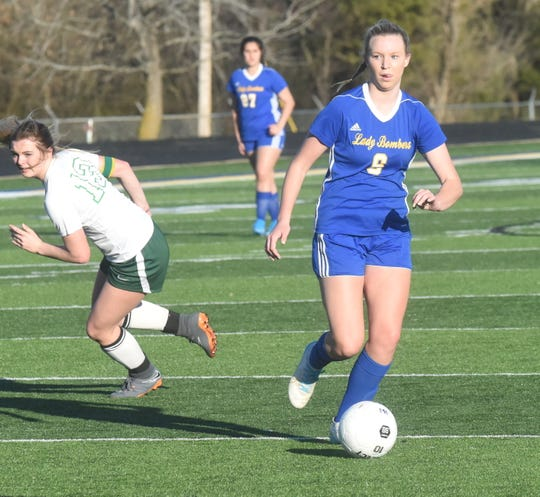Mountain Home's Sarah Swonger in action against Greene County Tech earlier this season at Bomber Stadium.