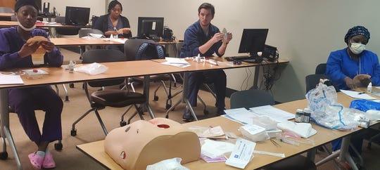 Patient care technicians train to help nurses as part of a program at Baptist Health.