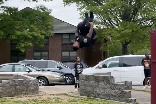 Patrol officer Paxton Montgomery thrills several children in a Nashville public housing complex when he does a backflip in full uniform.