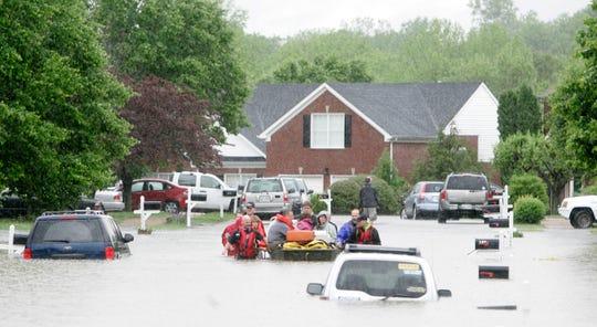 Franklin firemen rescue residents in Fieldstone Farms from flood waters in Franklin , Tenn., Sunday, May 2, 2010.