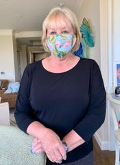 """Christine Hobbs of Naples made Florida-themed masks, like this pink flamingo. """"I had intended to use it for pillowcases for our boat but that never happened,"""" she said, """"so I found another use for it. It's an icebreaker with strangers and makes people smile."""""""
