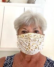 """Shari Mink says she began making masks from a request from Hope Lutheran Parish Nurse Sheila Morales.  """"The masks were for memory care units in the surrounding area. Several ladies from Hunters Ridge joined the effort and to date the HR Masketeers have made and distributed over 650 masks to memory care, cancer patients and Hunters Ridge residents and staff,"""" Mink said."""