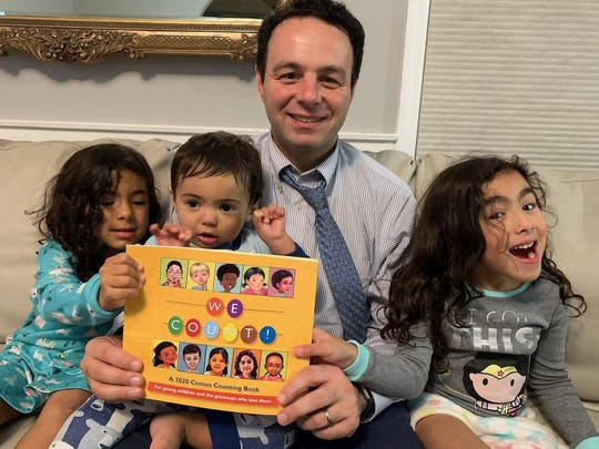 Mayor Andre Sayegh of Paterson reading to his three children Kayla, 4,  Ayden, 1, and Sophia, 6