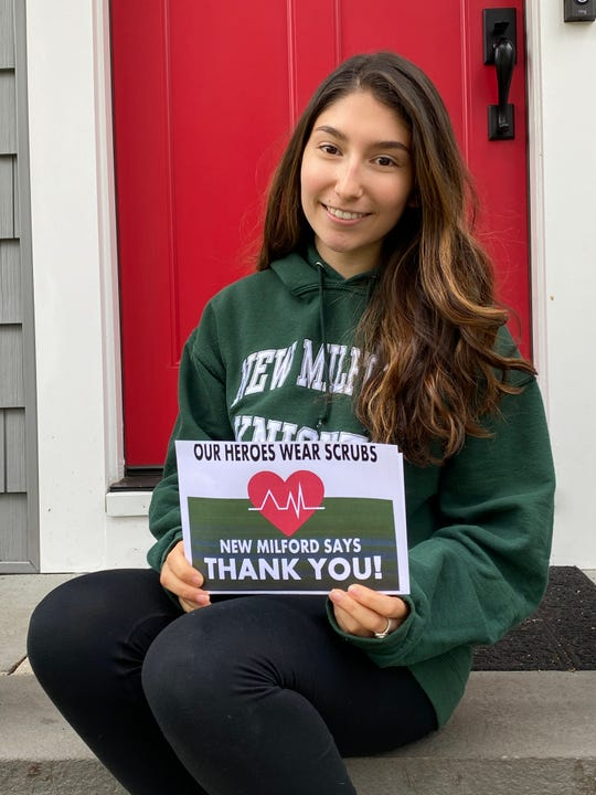 "New Milford resident Natalie Ix, a sophomore at New Milford High School, is designing and selling lawn signs, with the message, ""Our Heroes Wear Scrubs – New Milford Says Thank You!"" to feed healthcare and other essential workers."