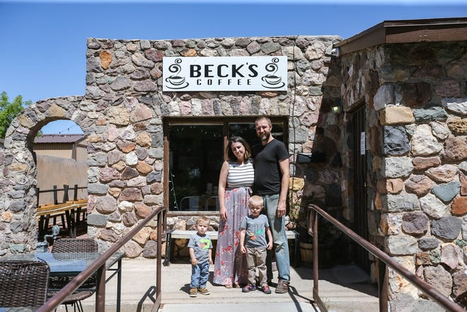 Arianna Parsons, her husband Tyrell Thacker and their sons Thomas and Vincent Thacker stand outside Beck's Coffee, in Las Cruces on Thursday, April 23, 2020.