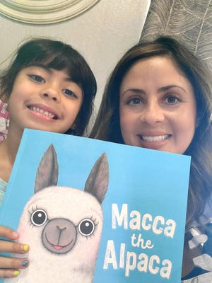 """Hope Morales, Executive Director for Teach Plus New Mexico, and her six-year old daughter Mila Morales read """"Macca the Alpaca on her Facebook page """"NM Nightly Read Alouds"""" where every night someone reads a book. Morales started the page when schools were shut down in March and hopes to continue the live readings."""