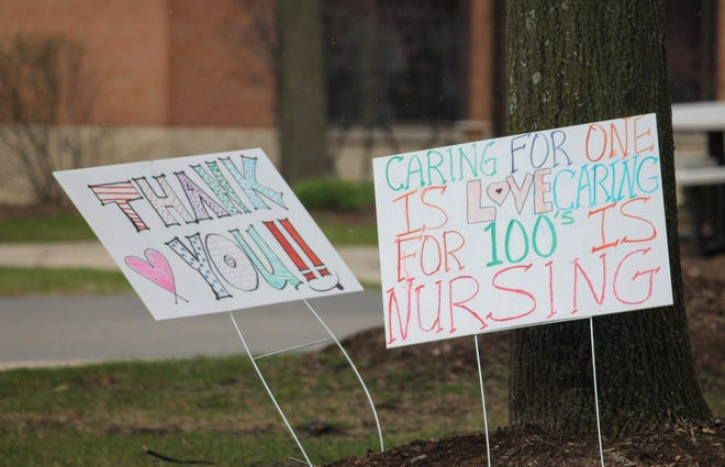 Signs outside Angela Hospice in Livonia.