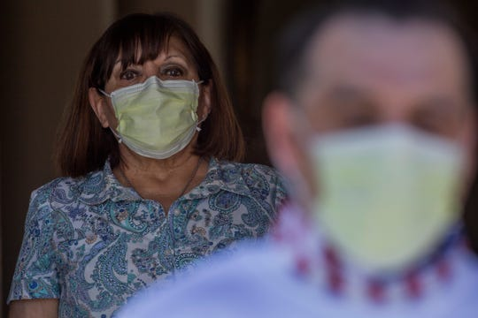 Oscar Holguin tested positive for COVID-19 and was released from Indio County Jail due to his health condition on April 23, 2020. He is photographed at home. His mother, Lucy Holguin, stands behind him at a safe distance.