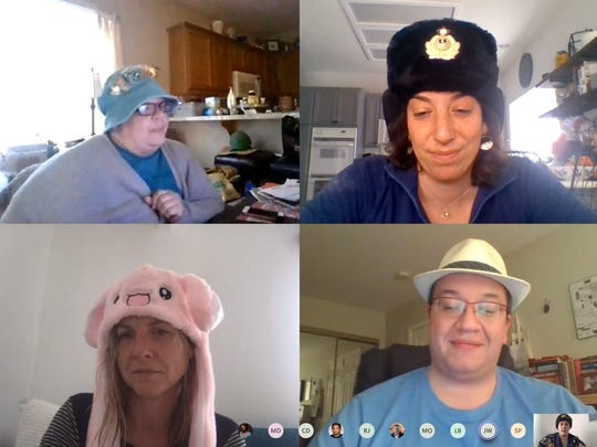 Desert Sun staff have a virtual meeting wearing funny hats on March 19, 2020.