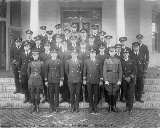 Newly-winged officers of Class XIX pictured in front of Building 16 as NAS Pensacola in February 1924.