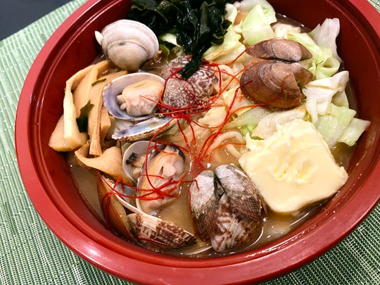 Miso butter ramen with tonkotsu miso base, Asari clams, pickled menma, wakame, green onion, cabbage, butter and chile threads from Gamo Men in Scottsdale.