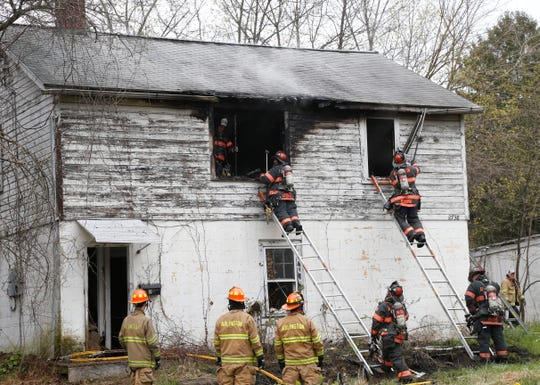 Firefighters respond to a structure fire on South Road in the Town of Poughkeepsie on April 23, 2020.