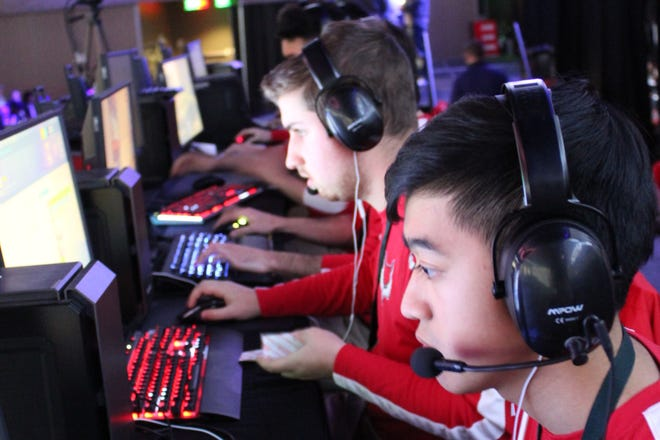 Members of Marist College's Esports team play games. The team won conference championships in League of Legends and Rocket League this year.
