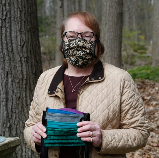 Hilary Richards holds several surgical masks she made for medical workers while at her home in the Town of Poughkeepsie on April 23, 2020. Richards was inspired to sew the masks to help out medical staff who helped her get through a bout of cancer.