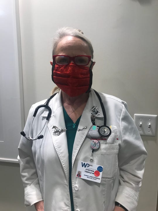 Cynthia Teeple, a nurse practitioner at White Plains Hospital's Center for Cancer Care, wears a surgical mask sewn and donated by Poughkeepsie's Hilary Richards, a former patient.