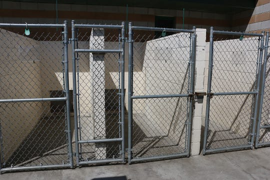 Outdoor dog kennels are seen empty at the Nevada Humane Society in Reno on April 23, 2020.