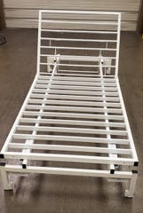The head portion of portable hospital beds manufactured by Contract Industrial Tooling raises to assist COVID-19 patients struggling to breathe.