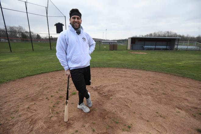 Conner Simonetti last played professional baseball in 2018, he's back in his hometown of Fairport and started as the assistant baseball coach this year before COVID-19 stopped the season before it began.  Simonetti works out at the track Thursday, April 23, 2020 with his father.  Simonetti holds the record for the most homers, 25, during his years 2011-2013 for Fairport High school.