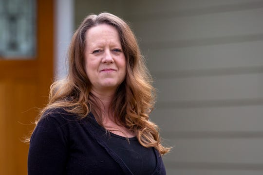 Kelly Nicholson of Salem was laid off from her job in March, but it took five weeks for her to get unemployment benefits from the state.