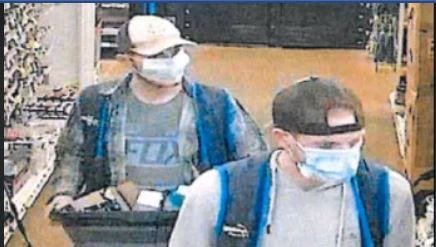 San Angelo police are urging these two men to turn themselves in after a video showed them stealing from Walmart while wearing employee vests, according to police.