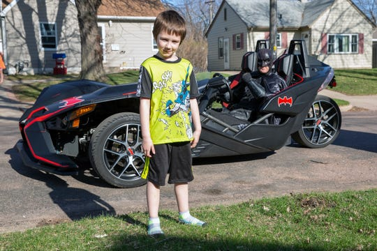 David Jurgens, 6, poses for a photo with Sioux Falls Batman on Wednesday, April 22.