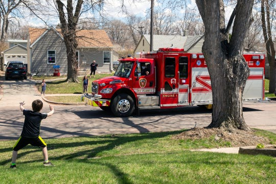 David Jurgens, 6, waves at a Sioux Falls Fire Rescue truck as it drives by for his birthday on Wednesday, April 22, 2020.