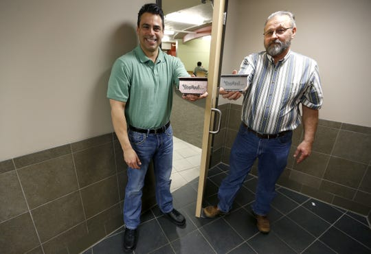Mike Sewell, left, Ron Ely and another business partner, not pictured, invented and brought to market the StepNpull, a hands-free way to open bathroom doors.