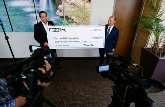 Darrel Hopkins with Prime Inc. presents a check to CoxHealth CEO Steve Edward during a press conference on Thursday, April 23, 2020. Prime donated $700,000 to the hospital to pay for its recently constructed COVID-19 wing.