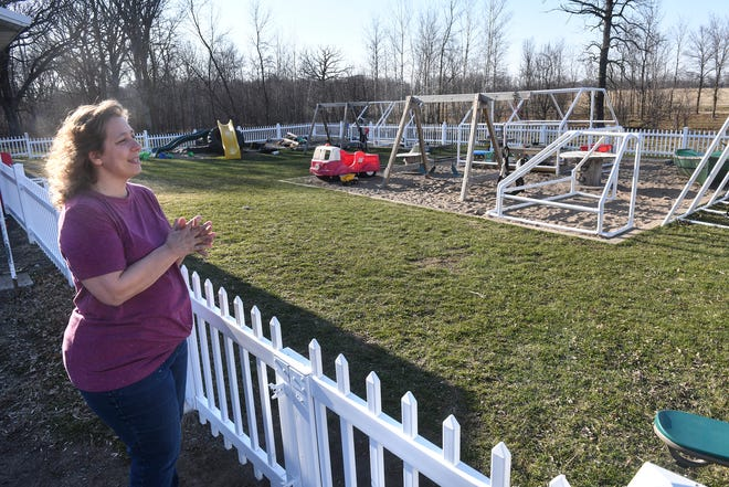BarbaraLee Malikowski talks about her business near the playground area Wednesday, April 22, 2020, at 40 Acres Childcare near Foley.