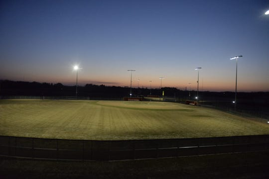 The sun was setting behind the Tech baseball field on Wednesday, April 22, 2020 at Tech High School as the lights shined upon the the field in #BeTheLight movement.