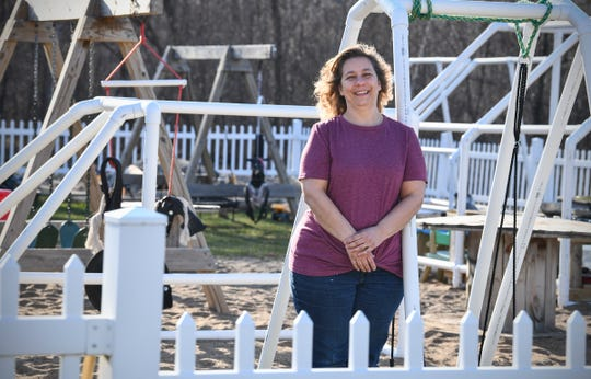 BarbaraLee Malikowski smiles while surrounded by playground equipment Wednesday, April 22, 2020, at her business, 40 Acres Childcare, near Foley.