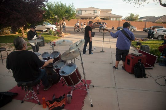The Ed Tracy Band performs from a driveway and out of the back of a car to entertain the community Wednesday, April 22, 2020.