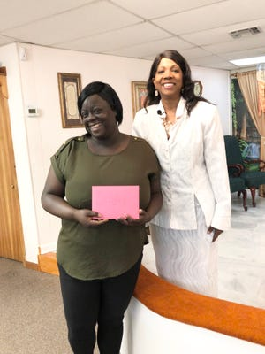 LaTreller Johnson,  a direct care professional at Tallahassee Developmental Center, a long-term residential care facility for adults with developmental disabilities, with Rosalind Tompkins, right, is receiving a HOPEE award.