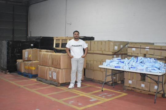 The Figgers Foundation donated more than 700,000 units of personal protective equipment to healthcare facilities in hotspots around the country. In the picture, Figgers Communications CEO Freddie Figgers stands near donations.
