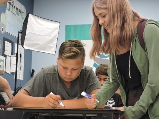 Seventh-grader Joel Martinez (left) works with Judyangel Silva on writing a script for a Lobo News segment when R.J. Frank Academy was in session. Currently the Oxnard campus is closed to prevent the spread of COVID-19.