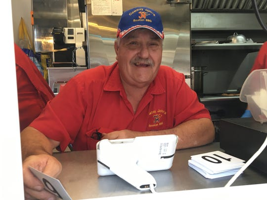 Former cattleman John Harvey launched his Cowboy John's Smoken BBQ food truck about four years ago, as an addition to an existing barbecue catering company. Now he's looking for ways to keep the business going amid coronavirus-era restrictions.