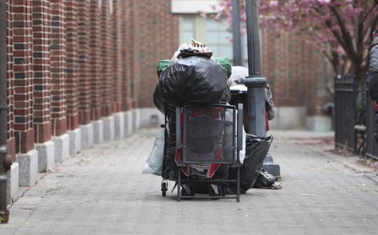 A shopping cart with someones possessions is parked  outside the Yonkers train station on Thursday, April 23, 2020.