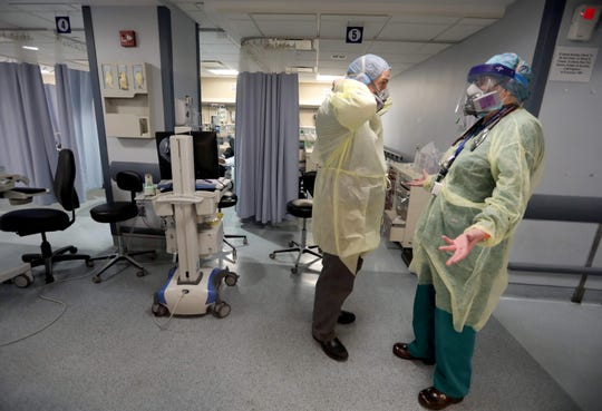 Catherine Hopkins, right, a nurse practitioner at St. Joseph's Medical Center in Yonkers, speaks with Dr. Anthony Leno, director of emergency medical services, in the hospital's emergency room April 22, 2020. Hopkins' regular job involves community outreach and school health, but she has been pressed into duty in other areas of the hospital due to the coronavirus pandemic.