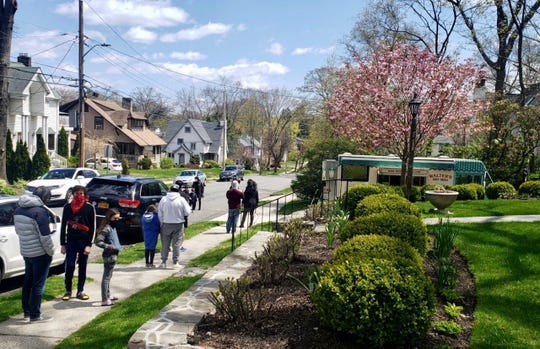 Neighbors stay six feet away during a Walter's Food Truck neighborhood run.