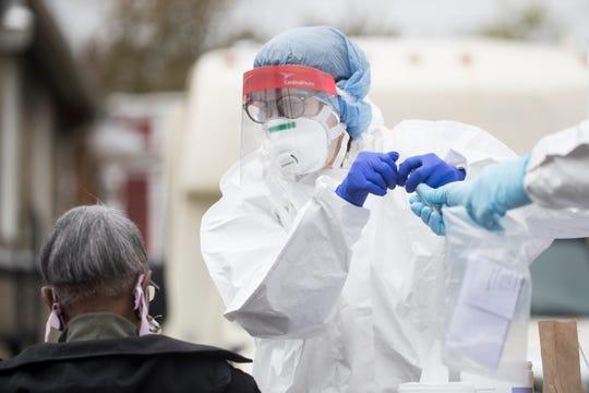Resident's in Wilmington's Southbridge neighborhood get tested for coronavirus Thursday, April 23, 2020, outside of the Henrietta Johnson Medical Center.