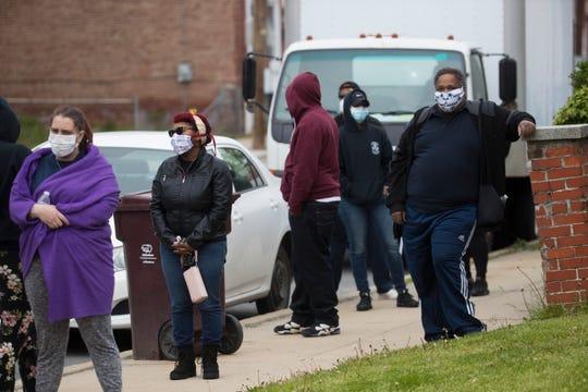 Residents in Wilmington's Southbridge neighborhood get tested for coronavirus Thursday, April 23, 2020, outside the Henrietta Johnson Medical Center.